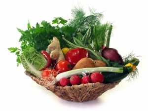 Colorful mix of many different fresh vegetables in a basket